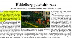 Heidelberg putzt sich raus! Aufbau am Marktplatz läuft auf Hochtouren - Rollrasen und Tribünen! Während die Polizei alles absichert, hat ein paar Meter weiter Joe Schwarz von Heidelberg Marketing alle Hände voll zu tun. Gestern Morgen klebte sein Ohr förmlich am Handy. Es gibt viel zu koordinieren für den hoheitlichen Besuch am Donnerstag!