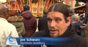 Joe Schwarz (Heidelberg Marketing GmbH) mit OTV auf dem Heidelberger Weihnachtsmarkt 2018